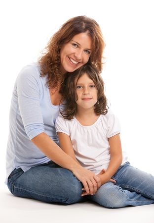 blonde mom: Mother and daughter in an affectionate pose on a white background Stock Photo