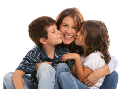 man woman kissing: Son and daughter kissing mother on a white background