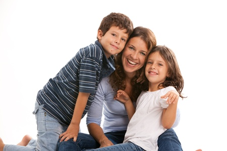blue jeans kids: Mother, son and daughter with a happy expression on a white background Stock Photo