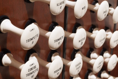 Close up view of the stop knobs of a church pipe organ Stock Photo