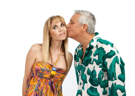 Beautiful woman kissed by a handsome middle age man Stock Photo - 11876503