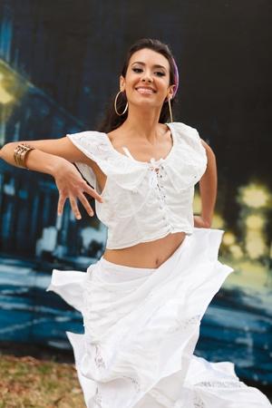 Beautiful young woman outdoors flamenco dancing
