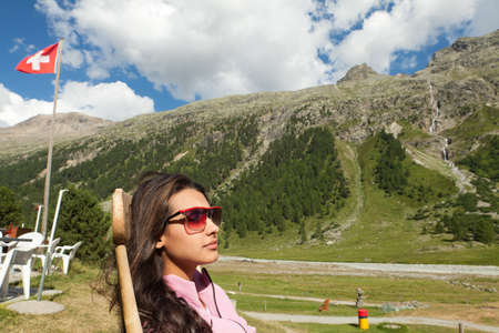 Pretty young woman relaxing in the Swiss Alps photo