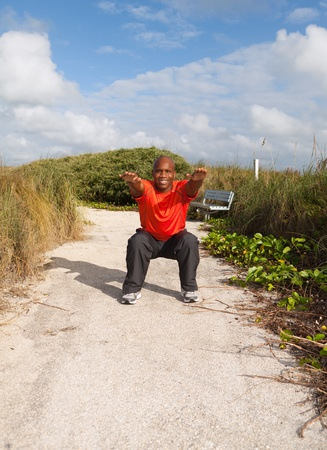 Handsome personal trainer exercising in Miami South Beach park Stock Photo - 11928055