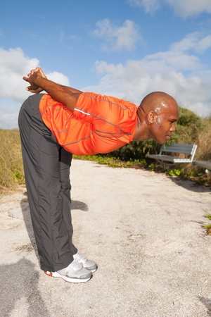 Handsome personal trainer exercising in Miami South Beach park Stock Photo - 11928050