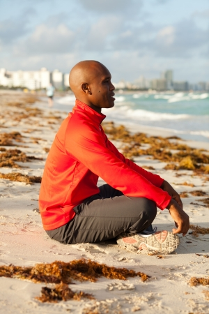 yoga outside: Handsome young man meditating in Miami South Beach