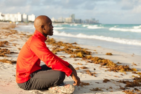 Handsome young man meditating in Miami South Beach photo