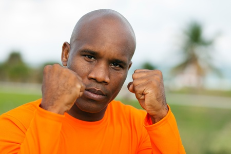 stance: Handsome young man in a boxing pose outdoors Stock Photo