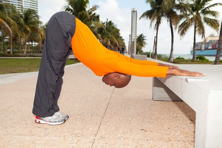 Personal trainer exercising in South Beach in Miami Stock Photo - 12467829