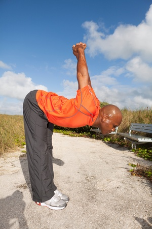 Personal trainer exercising in South Beach in Miami photo