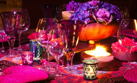 Elegant colorful dinner table setting Фото со стока
