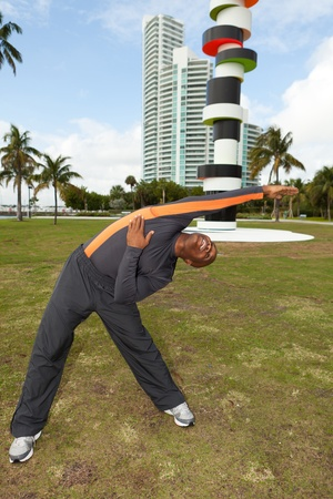 Handsome personal trainer exercising in Miami Beach