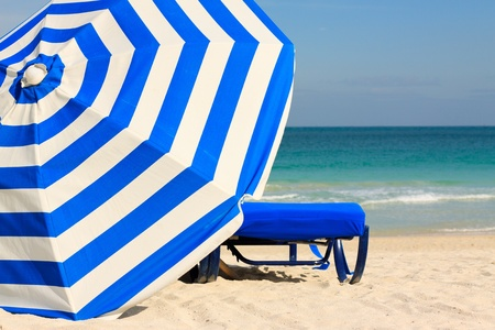 Colorful umbrella and lounge chair in South Beach in Miami photo
