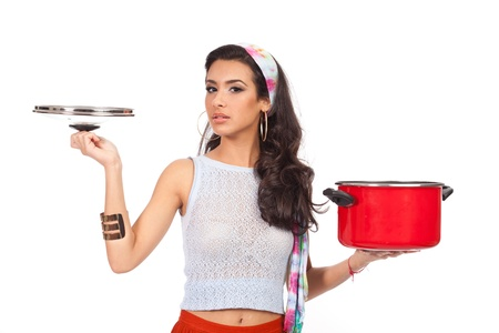 Beautiful young woman with cookware on a white background photo