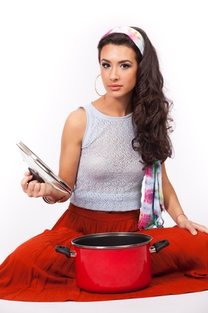 Beautiful young woman with cookware on a white background Stock Photo - 13108067
