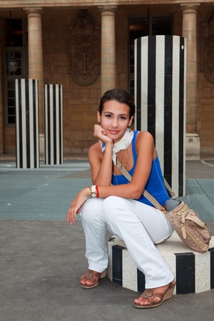Beautiful young woman resting in a Parisian plaza photo
