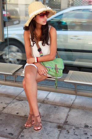 Beautiful young woman waiting for a bus in the French Riviera photo
