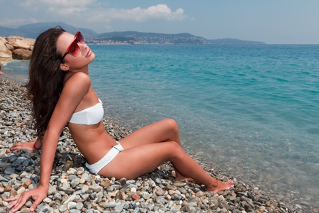 Beautiful young woman on the French Riviera photo