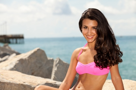 Beautiful young woman at the beach