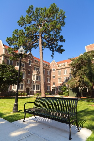college campus: Old fashioned red brick university dormitory or residence hall building