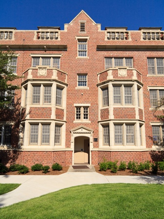 residence: Old fashioned red brick university dormitory or residence hall building