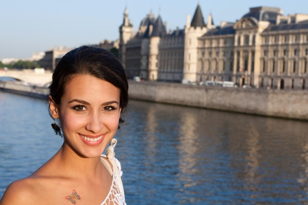 Beautiful young woman enjoying the sights of Paris along the River Seine photo