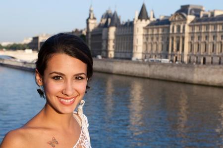 Beautiful young woman enjoying the sights of Paris along the River Seine Stock Photo - 13218760