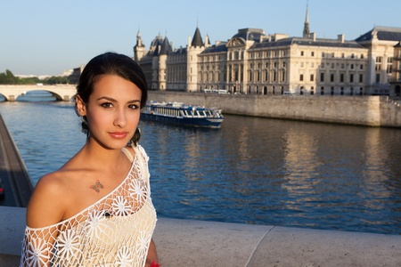 Beautiful young woman enjoying the sights of Paris along the River Seine Stock Photo - 13218762