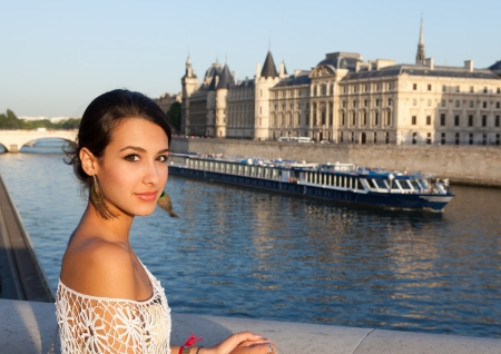middle eastern ethnicity: Beautiful young woman enjoying the sights of Paris along the River Seine