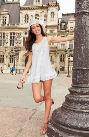 Beautiful young woman enjoying the sights of Paris posing in a popular plaza