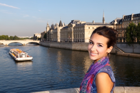 Beautiful young woman enjoying the sights of Paris along the River Seine