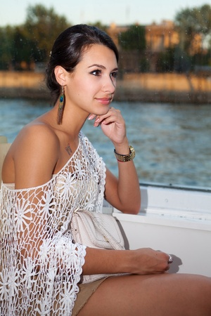 Beautiful young woman enjoying the sights of Paris in a water taxi along the River Seine Stock Photo - 13218806