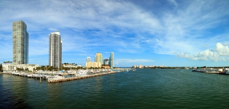Beautiful Miami Beach intracoastal waterway with marina and hi rise condos and Fisher Island in the background photo