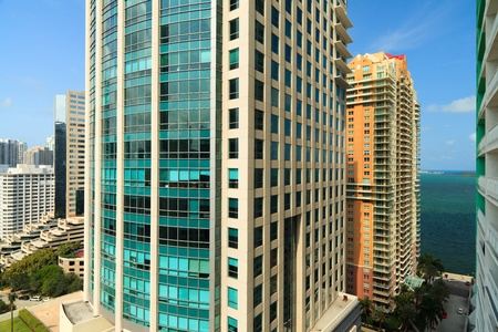Cityscape view of the Brickell Avenue area in downtown Miami with office buildings, skyscraper condominiums and Biscayne Bay