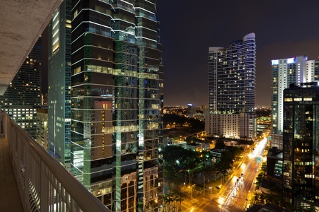 balcony: Night cityscape view of the Brickell Avenue area in downtown Miami with office buildings and skyscraper condominiums