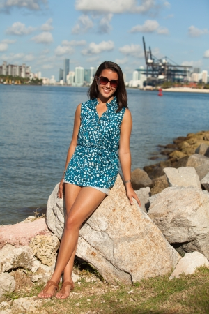 Pretty young woman enjoying the beach Stock Photo - 14546234