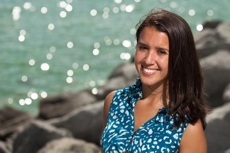 Pretty young woman enjoying the beach  photo
