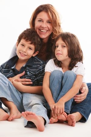 blue jeans kids: Pretty young mother with son and daughter isolated on a white background  Stock Photo