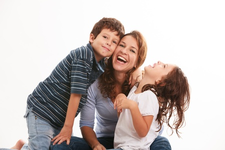 on a white background: Pretty young mother with son and daughter in a fun pose isolated on a white background