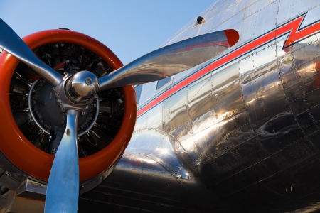 vintage power: Close up view of a vintage DC-3 propeller passenger and cargo airplane. Editorial
