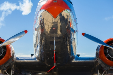 Close up view of a vintage DC-3 propeller passenger and cargo airplane.
