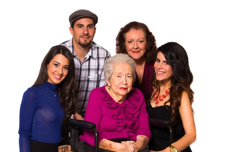 Family with their handicapped grandmother on a white background  Stock Photo - 16513316