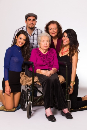 Family with their handicapped grandmother on a white background  Stock Photo - 16513302