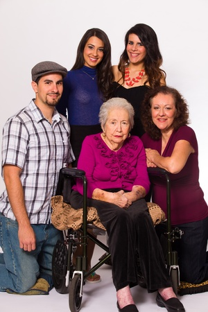 Family with their handicapped grandmother on a white background Stock Photo - 16513305