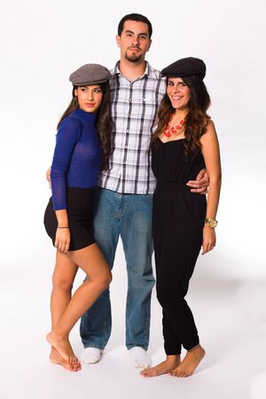 Handsome young man and pretty young women on a white background. photo
