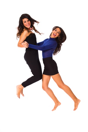 Beautiful young women jumping and having fun on a white background.