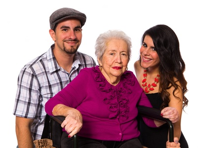 Grandchildren with their elderly handicapped grandmother on a white background. photo
