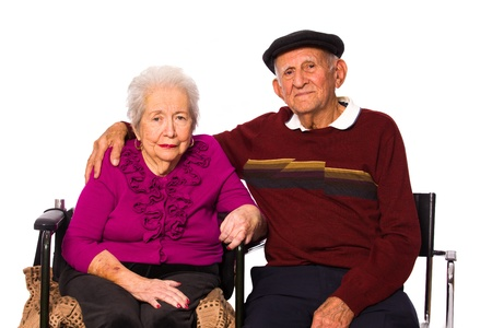 Elderly married couple on a white background. photo