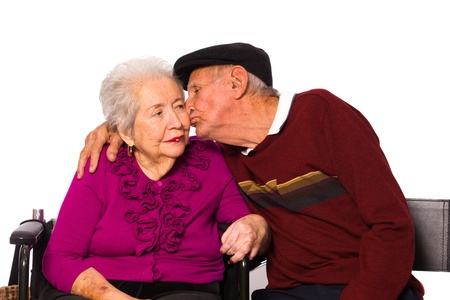 Elderly married couple with an affectionate pose on a white background. photo
