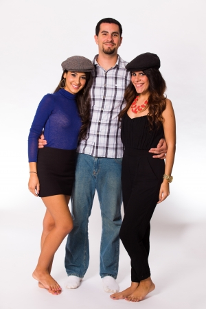 man with a goatee: Handsome young man and pretty young women on a white background. Stock Photo